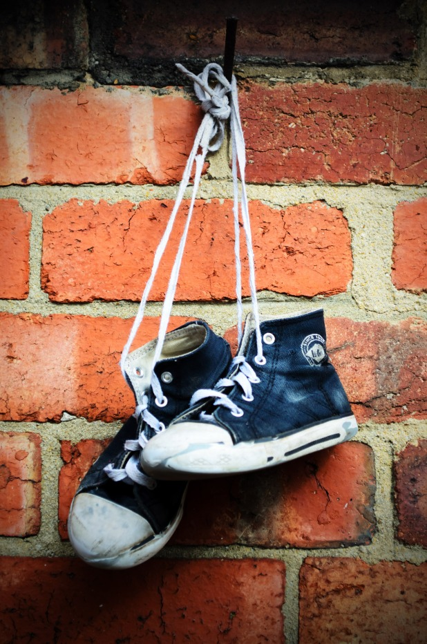 old-sneakers-on-the-wall